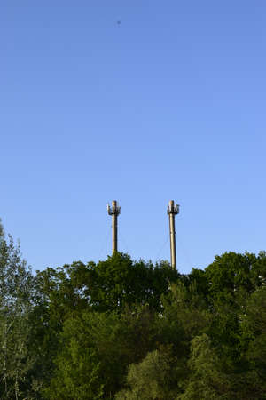 Cellular antennas at the top of the chimney. Telecommunications tower. Receiver-transmitter of the signal. Cellular aerials repeater.