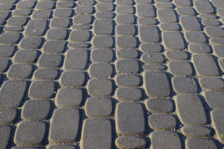 Abstract background - gray paving slabs close-up. Stock Photo