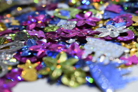 Multicolor glitter vintage lights background. Defocused glittering shine lights background. Blur of Christmas decorations concept. Holiday festival backdrop with sparkles, celebrations display.