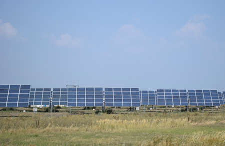 Solar power station in arid area under clear blue sky. Solar power equipment. Solar panel, photovoltaic, alternative electricity source. Stock Photo