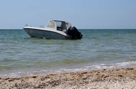 Motor boat on the background of the sea near the coast.