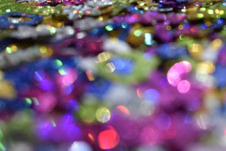 Multicolor glitter vintage lights background. Defocused glittering shine lights background. Blur of Christmas decorations concept. Holiday festival backdrop with sparkles, celebrations display. Zdjęcie Seryjne - 129136143