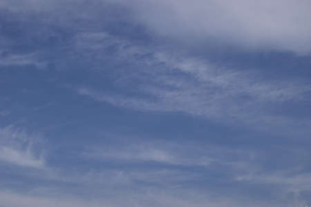 Fantastic soft white clouds against blue sky. Blue sky with cloud. Clearing day and Good weather in the morning. Imagens