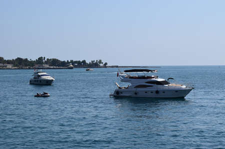 Jetski and yachts on the sea. Clear sea blue sky. Motor transport in the sea, scutter and boats. Antalya, Turkey