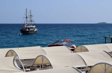 Large sailing ship in the Mediterranean sea in a pirate style in the open sea against a blue sky. The concept of summer holidays, sports, tourism. Pirate cruise sail ship, Tekirova, Turkey 新闻类图片