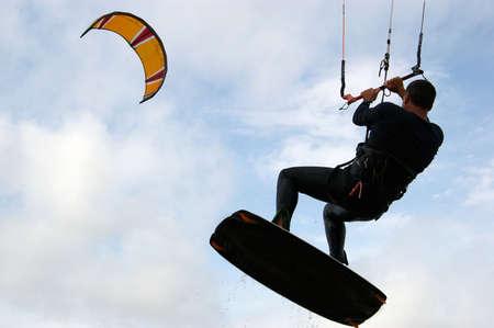 kite surfing: A man kite surfing