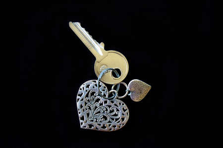 door lock love: House key with heart shaped keyring Stock Photo