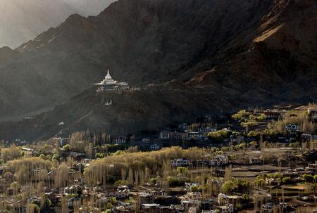 High angle view of Shanti Stupa and Leh city in autumn with Himalaya range background, Jammu and Kashmir, India.