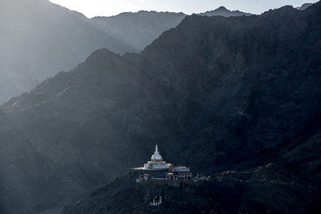 Shanti Stupa with Himalaya range background, Jammu and Kashmir, India. Stock Photo