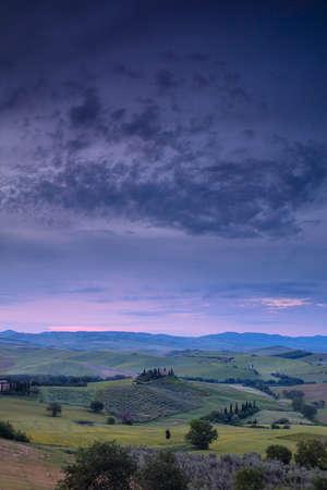 sunrise over the Belvedere farmhouse, Val DOrcia, near San Quirico Tuscany