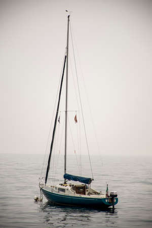 anchored: Italy a anchored sailing boat at the Italian Riviera - Liguria Stock Photo