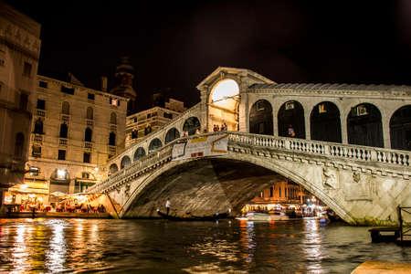 The big canal Rialto Bridge in romantic Venice in Italy by night