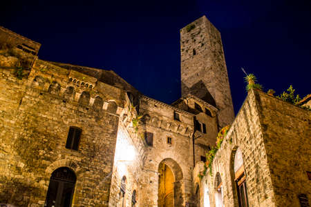 Romantic night light in the toscany San Gimignano by night Stock Photo