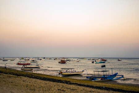 sanur: Bali in Indonesia boats harbor at Sanur Beach sunset