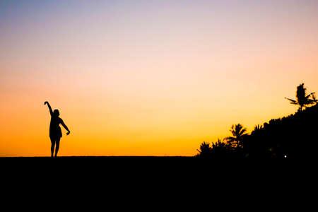 sanur: Bali in Indonesia dancing girl silhouette at Sanur Beach sunset