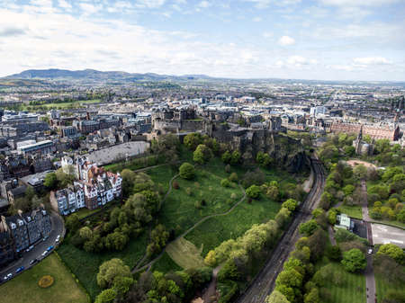 castle rock: Edinburgh city the historic Castle Rock sunny Day Aerial shot 4