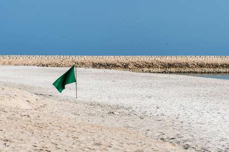 Flag swimming danger sign at the beach souly bay salalah Oman