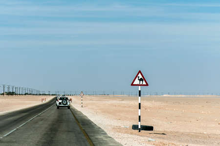 Camel warning sign desert highway in dhofar salalah Oman the Middle East