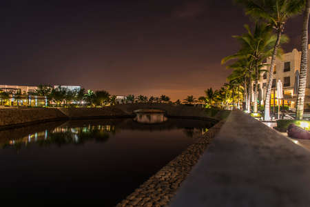Amazing night lights in Sultanate Oman Souly Bay harbour and Hotels Oceanside 4 Stock Photo