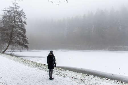 Girl lonely walking path and trees Winter wonder land 2 Standard-Bild
