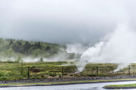 Great Geysir Strokkur in Iceland hot fog geology
