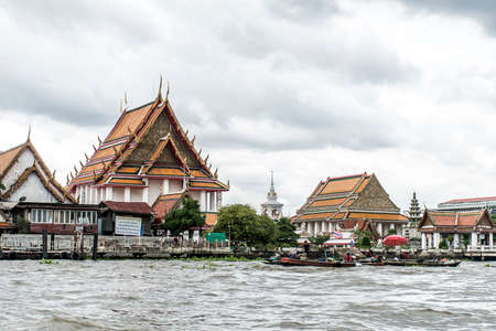 Bangkok Thailand 03.10.2015 Wat Temple architecture river merchants local people on boats Editorial
