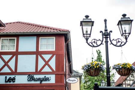 Roermond Netherlands 07.05.2017 Logo of the Lee wrangler jeans Store in the Mc Arthur Glen Designer Outlet shopping area