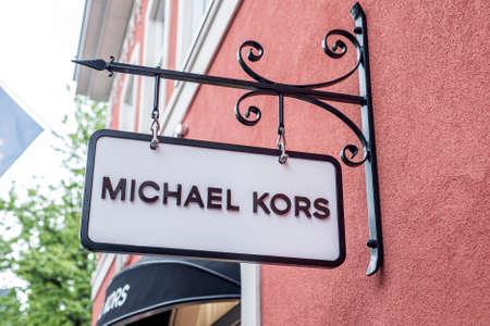 Roermond Netherlands 07.05.2017 Logo of the MK - Michael Kors Store in the Mc Arthur Glen Designer Outlet shopping area