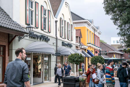 Roermond, Netherlands 07.05.2017 People walking around at the Mc Arthur Glen Designer Outlet shopping center area Editorial