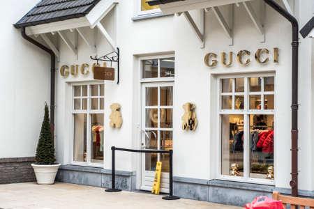 Roermond, Netherlands 07.05.2017 Logo and shop of GUCCI Store Mc Arthur Glen Designer Outlet shopping area