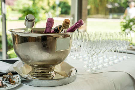 rose flowers ice cooled sparkling wine and champagne bottle in bucket copyspace text space Stock Photo