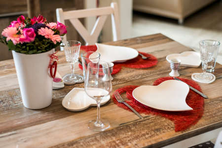 Valentines day dinner with setting romantic love for two wooden table red heart shape Copy space Stock Photo