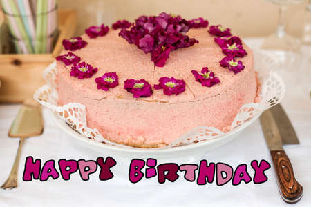 Close Up Cream Cake With Violet Flowers On Top Silverware And