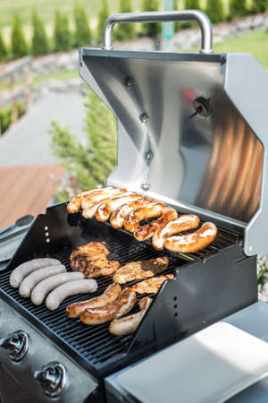 inlay: Barbecue grill bbq on propane gas grill. steaks bratwurst sausages meat meal