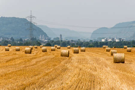 harvested: harvested field agriculture with straw bales during summer germany near Andernach Stock Photo