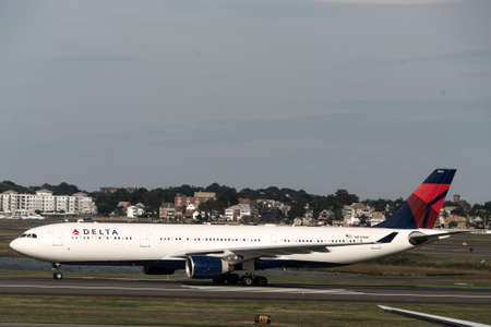 Boston Massachusetts USA 23.09.2017 - Delta Airlines jet planes driving to terminal gates at Logan Airport