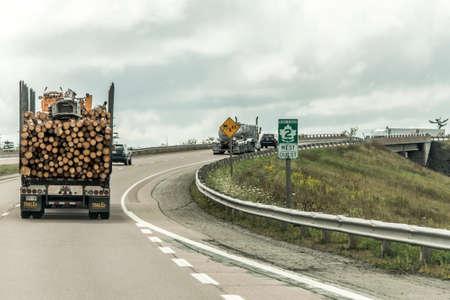 Quebec Canada 09.09.2017 Big Logging truck moving trans canada highway wood harvest field plant Canada ontario quebec
