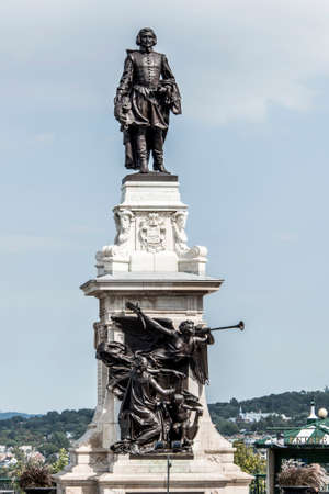 Statue of Samuel de Champlain against blue summer sky in historic area founder of Quebec City, Canada