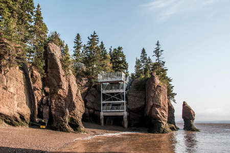 Platform metal at The famous Hopewell Rocks geologigal formations at low tide biggest tidal wave Fundy Bay New Brunswick Canada Stock Photo