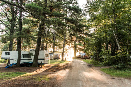 Sunset at Lake of two rivers Campground Algonquin National Park Beautiful natural forest Canada Parked RV camper