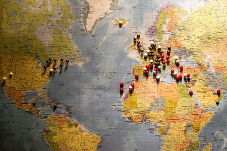 Picture of World Map Travel concept with many pushpins spherical pins Archivio Fotografico