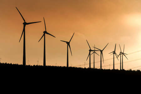 Black Silhouette of windturbines energy generator on amazing sunset at a wind farm in germany Imagens