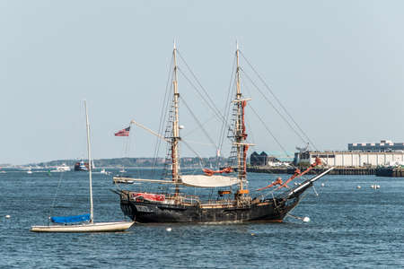 Boston USA 05..09.2017 Old and modern small Sailboat sailing boats side by side anchored in the harbor of Boston