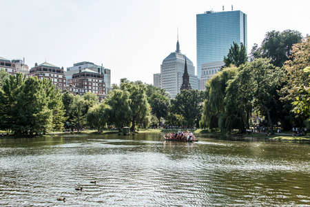 Boston, Massachusetts, USA 06.09.2017 tourists enjoying ride on famous swan boats at Boston Public Garden sunny day