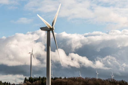 A panorama view over wind farm landscape in Germany with white generator turbines Stock Photo