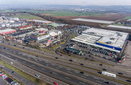 Germany Koblenz 03.04.2018 Aerial view of shopping market Metro and Media Markt during shpping rush hour