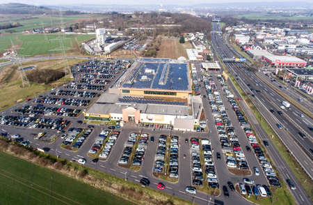 Germany Koblenz 03.04.2018 Aerial view of shopping market Globus with huge parking lot during shpping rush hour Editorial