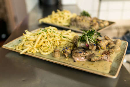 Spaetzle german baked gnocchi with chicken meat, champignons mushrooms, asparagus and cheese