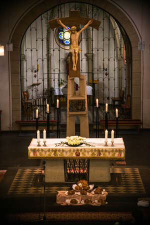 Rieden Germany 15.04.2018 Altar Setup with jesus Christ on the Cross hang behind the altar of the local church of Rieden