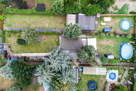Aerial photo with the drone, a new build-up plot with single houses and gardens, narrow neighbourhood